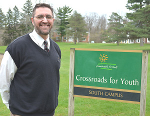 After 15 years with Crossroads for Youth, Marc Porter has been named president of the agency. He and his family will live on the 320-acre campus in Oxford. Photo by C.J. Carnacchio.
