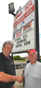 Tom Toteff (left), the former owner of Tom's Hardware in Oxford, turns over the keys to his store to Marv Stone, who plans to re-open the 558 S. Lapeer Rd. building in the fall as the fifth location of Stones Ace Hardware. Photo by C.J. Carnacchio.