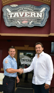 Oxford firefighter Kevin Snell (left) and Lindon Palushaj, co-owner of the 24th Street Sports Tavern, are teaming up to keep local children safe. Photo by Elise Shire.