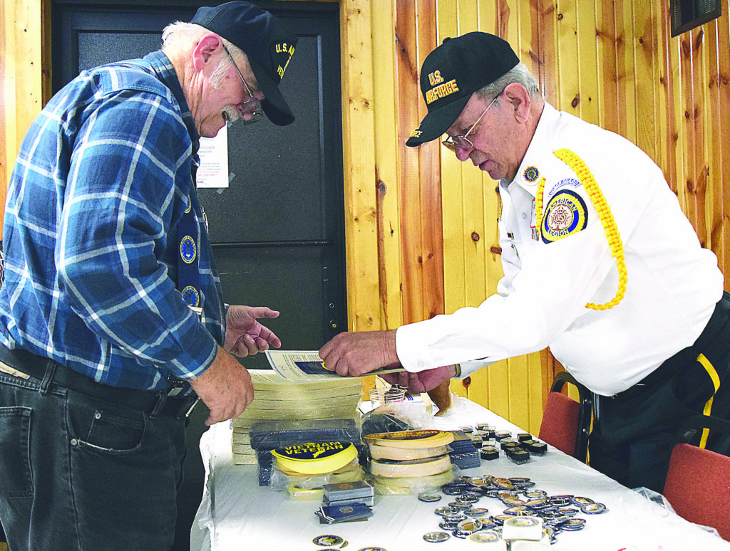 Pontiac resident and Vietnam-era vet Ronald Helm (left) receives his lapel pin from Mike Hardy, third state commander of the American Legion.