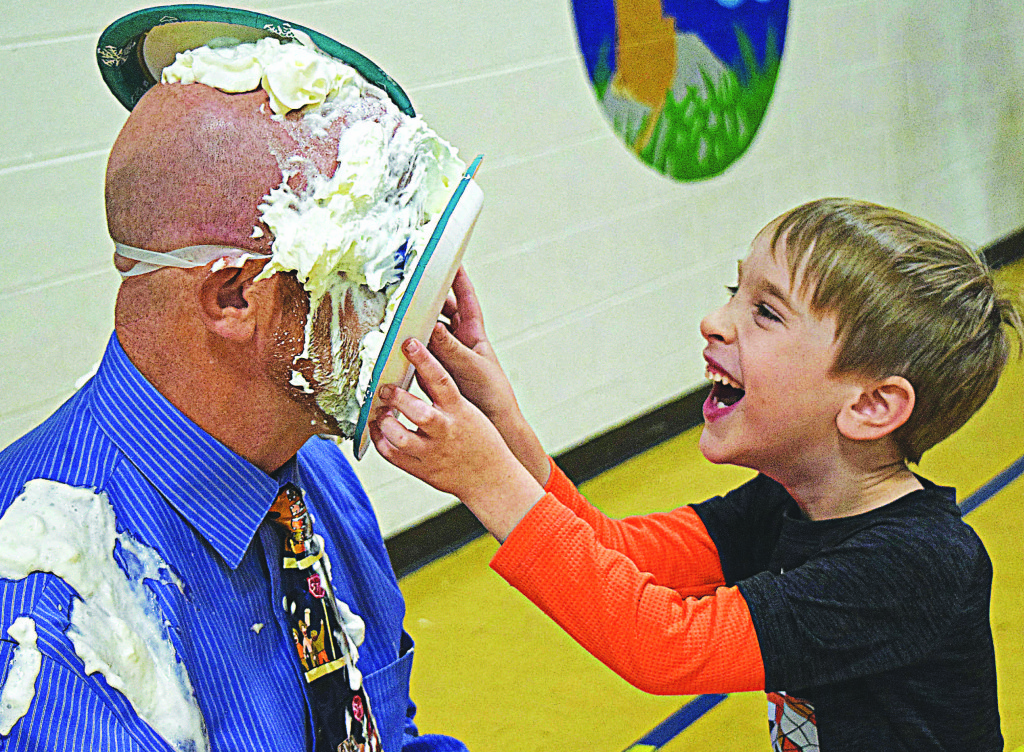 Ian Hafeli was one of 26 lucky Daniel Axford Elementary students who got to smoosh cream pies in the face of Principal Chad Boyd. That looks sticky.