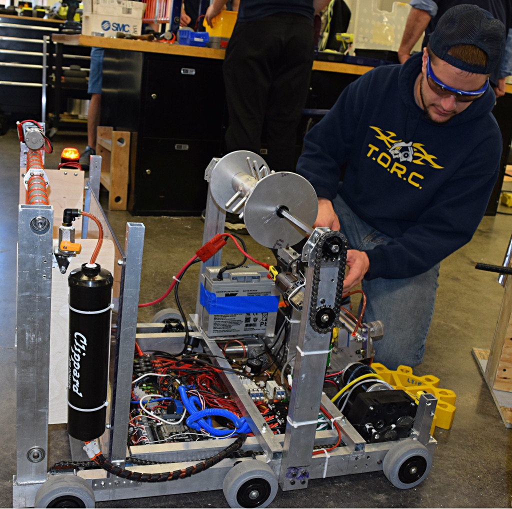 TORC 2137 Mentor Dante Zuccaro makes some adjustments to the team's practice robot.
