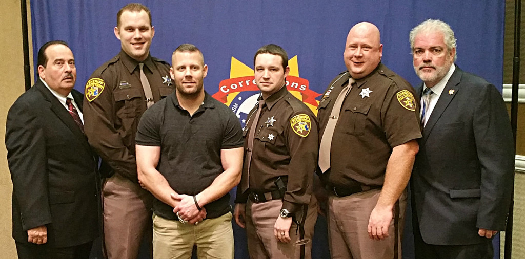 Flanked by Corrections USA Chairman James Baiardia (far left) and Treasurer Todd Dunn (far right) are Oakland County Sheriff's deputies Daniel Drwencke, Steven Pryde, Brandon Hall and Chad Acheson. Photo provided.