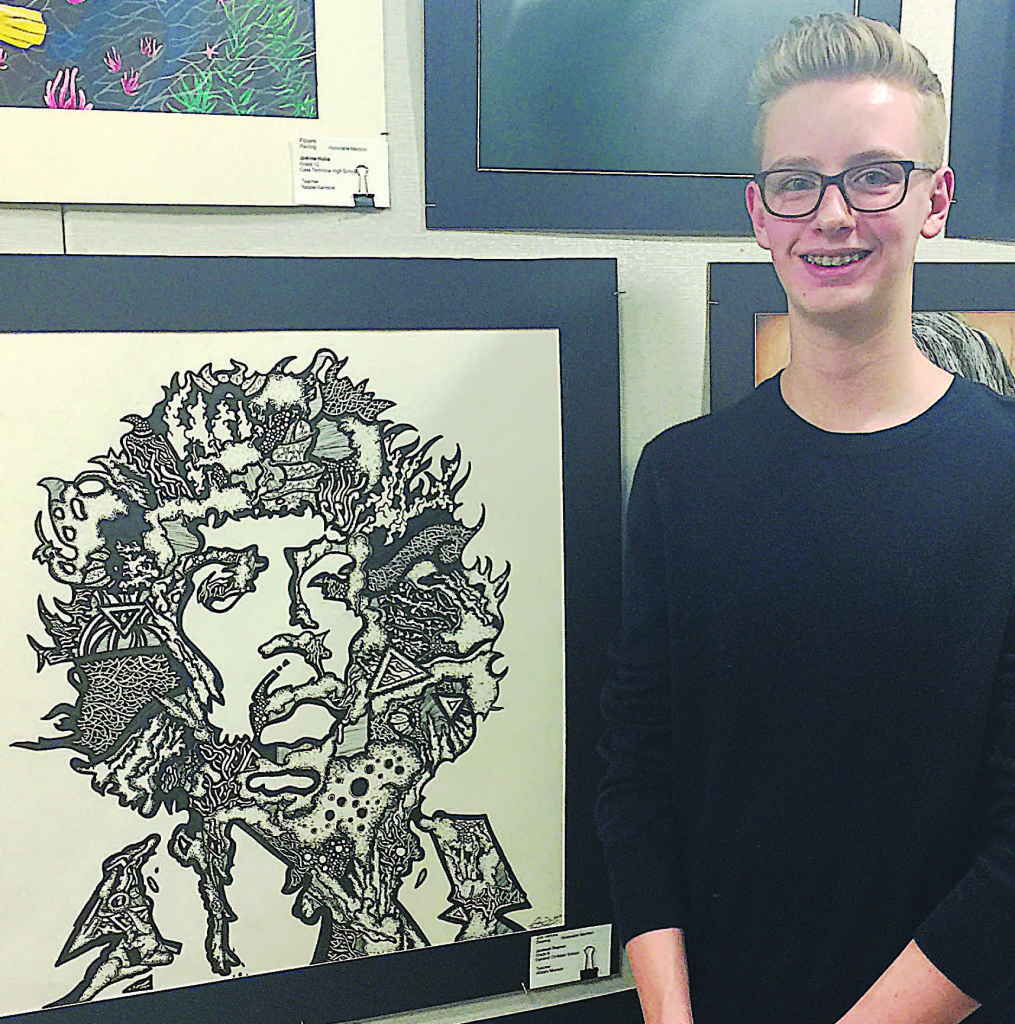 Artist Jackson Dupree, 14, of Oxford, poses with the ink drawing he created depicting legendary 1960s rock musician Jimi Hendrix. The piece won an honorable mention at the 2017 Southeastern Michigan Region of the Scholastic Art Awards. Photo provided.