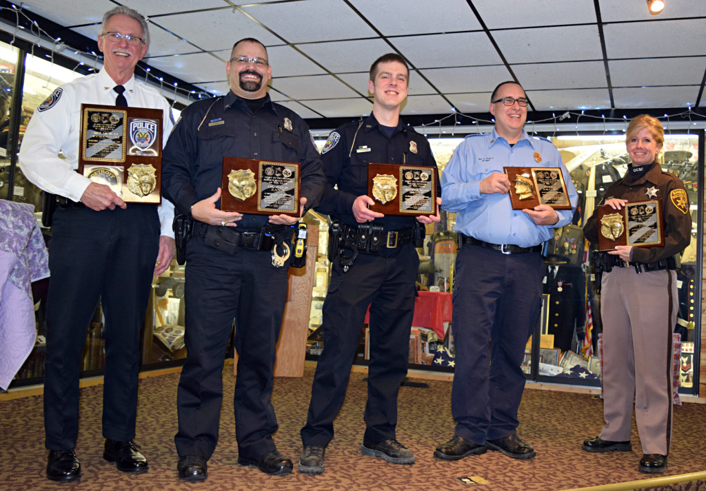 Honored with awards from American Legion Post 108 were (from left) Oxford Village Police Chief Mike Neymanowski, Reserve Cpl. David Zanin, Officer Sean Brown, Oxford Fire Sgt. Kelly Kilgore and Oakland County Sheriff's Deputy Amy Wakerly. Photo by Elise Shire.