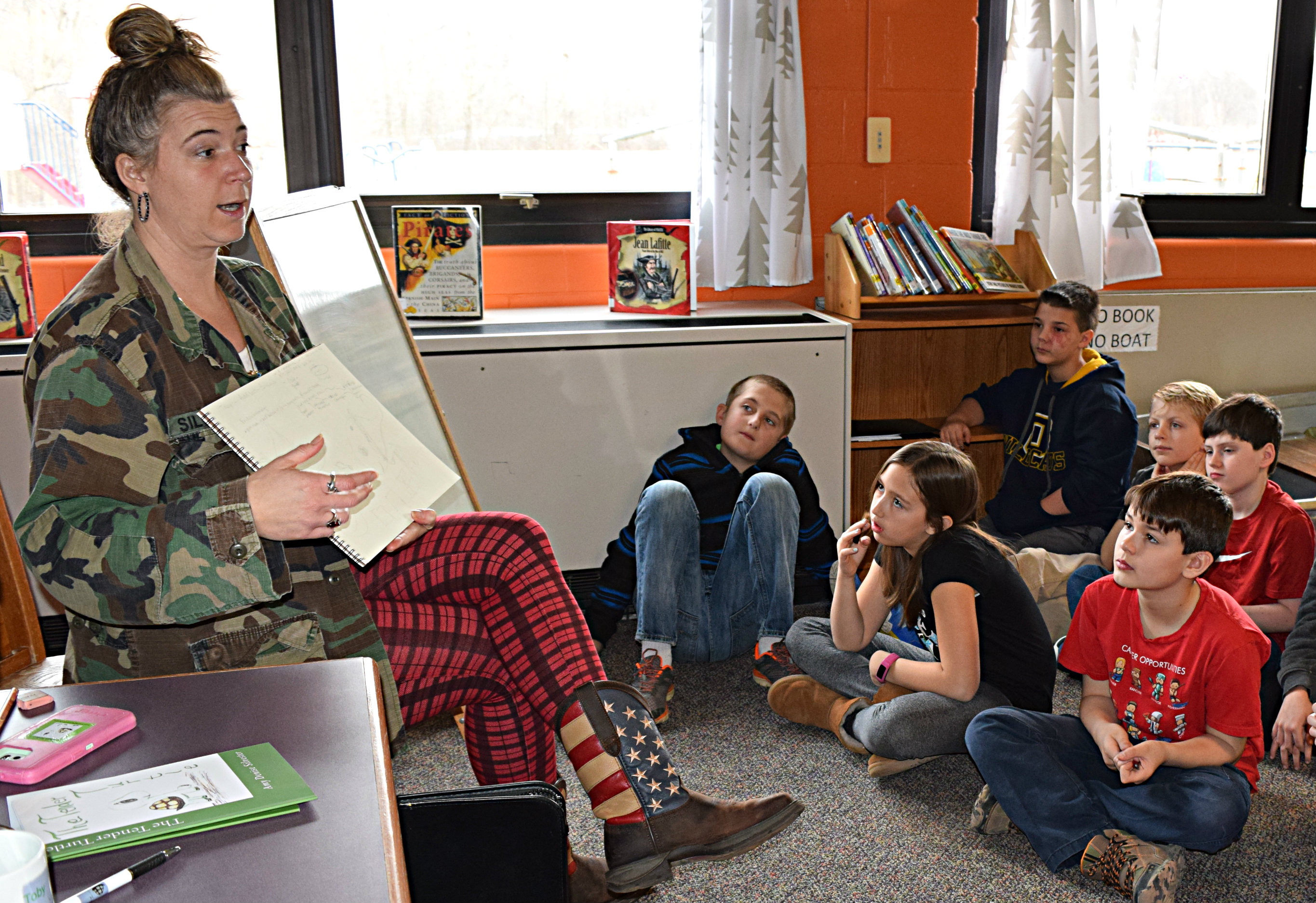 Children's author/illustrator Amy Silvester (left) discusses story ideas with Leonard Elementary students during her March 24 visit to the school. Photo by Elise Shire.