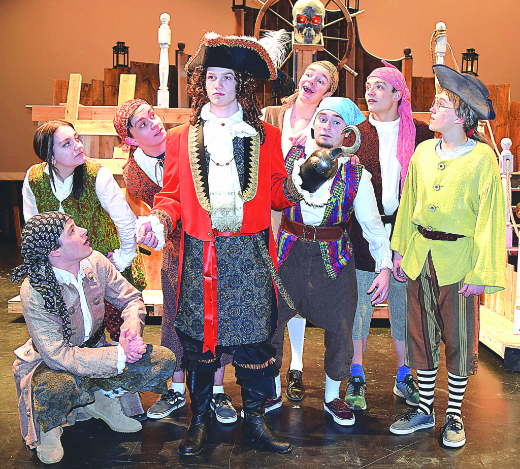 Captain Hook played by Josh Krol (center) and fellow pirates (from left) Drake Skikiewicz (front left), Charity Garner, Ian Malinowski, Andrew Wassell (back), Jacob Donovan (front), Trenton Sabo (back) and Skylar Ryskamp (far right). Photo by Elise Shire.