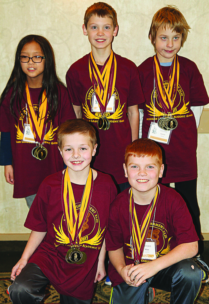 Team Trouble consisted of (back-left, clock-wise) Jenna Duong, Owen Pavloc, Gavin Feiner, Max Lovins, and Luke Diegel. The team won four state championships at the Academic Games held March 1-3.