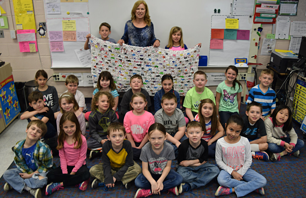 Daniel Axford Elementary teacher Renee Green's second-grade class used recycled plastic bags to help make sleeping mats for homeless people. Photo by Elise Shire.
