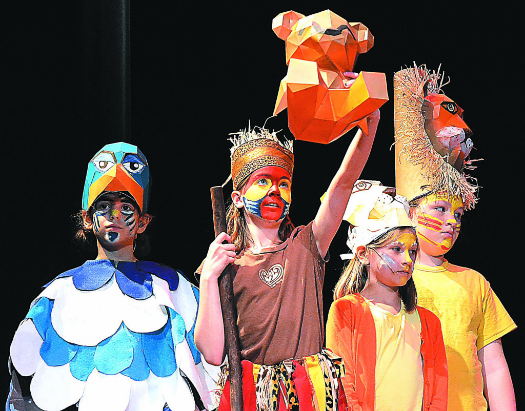 Leonard Elementary students (from left) Evangeline Lulgjuraj, Eva Rayner, Evelyn Rippetoe and Sarah Phelps perform in Disney's The Lion King KIDS, put on by the school's theatre club. Photo by C.J. Carnacchio.