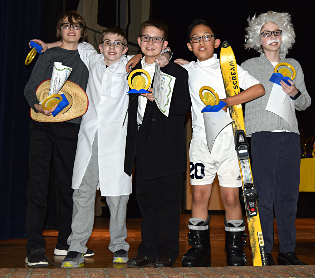 Sixth-graders Charlie Fletcher (from left), Jackson Brandt, Drake Krawczyk, Michael Duong and Dale Schmalenberg show off their trophies following their big victory at the OMS Battle of the Books last week. Photo by Elise Shire.