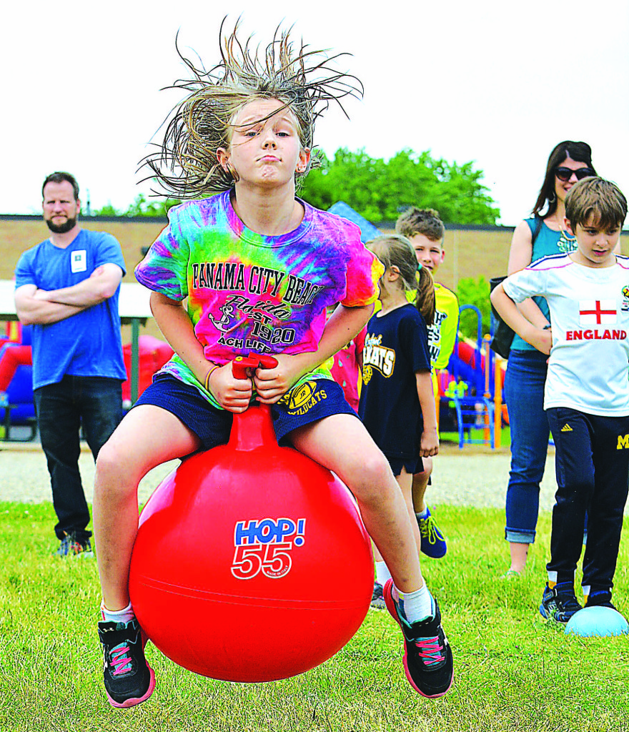 First-grader Riley Zyngier races down the field on a hopper ball.