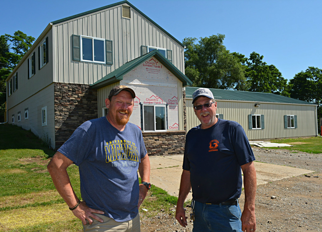 Parks/Rec. Director Ron Davis (left) and  Park Supt. Jeff Kinasz stand outside the  department's new administrative offices.