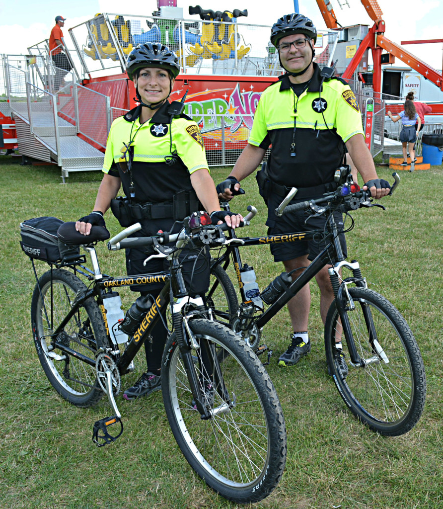 Oakland County Sheriff's deputies Brandy Mendicino (left) and Jim Willyard makeup Oxford Township's new bike patrol. Photo by C.J. Carnacchio.