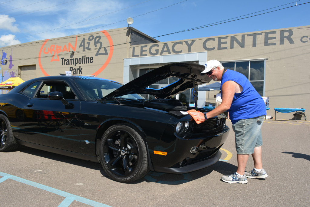 Wiping down his limited-edition Mopar 2014 Dodge Challenger  is Orion resident James Johnson. Only 100 were made that year.