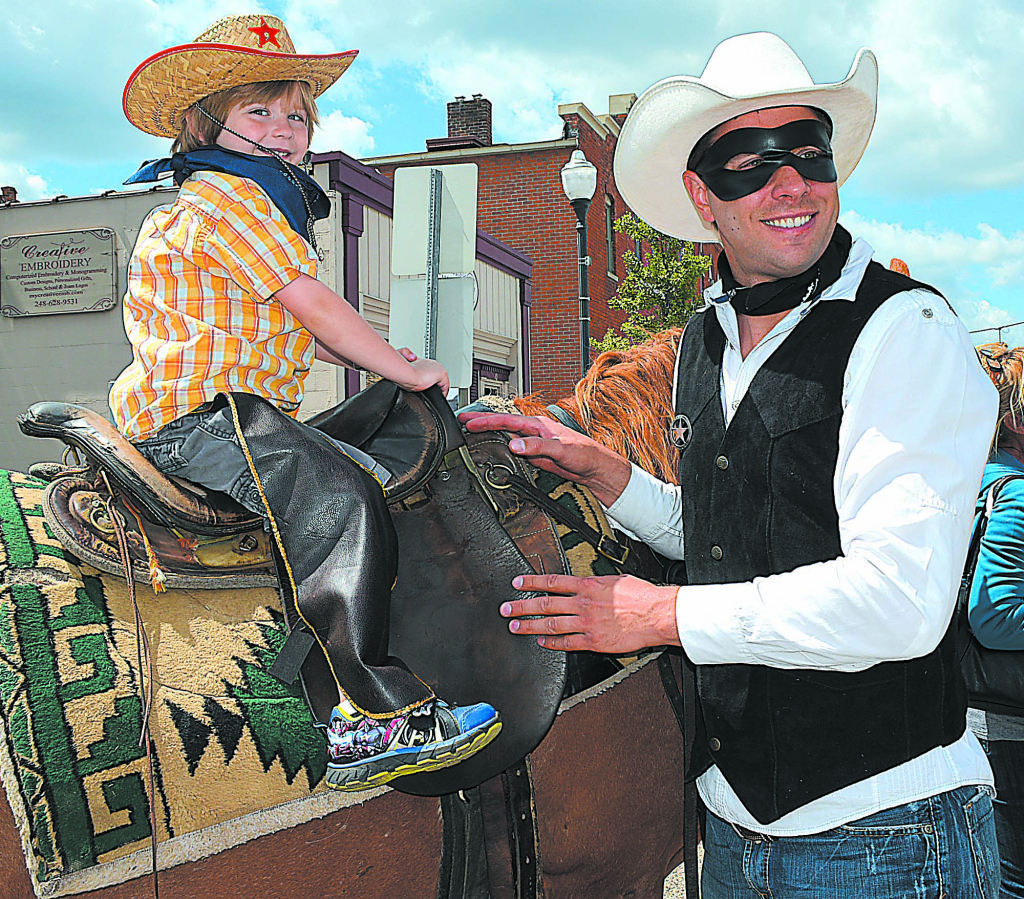 Nickoli Nelson, 4, of Oxford, poses with Oxford's official Lone Ranger, Jason Van Duyn. The little lawman looks good in the saddle.