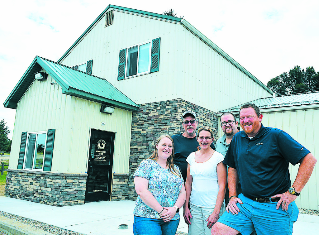 The staff of the Oxford Twp. Parks and Recreation Dept. is now conducting business from their new administrative offices in Seymour Lake Park. Pictured are (from left) Lauren Jacobsen, Jeff Kinasz, Dawn Medici, Dan Sullivan and Ron Davis. Photo by CJC.
