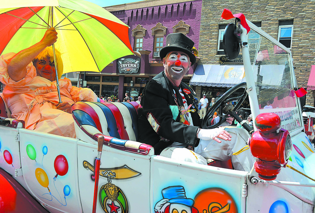 Shriner Clown Steve Gotham, of Hadley Township, was all smiles as he drove along M-24.