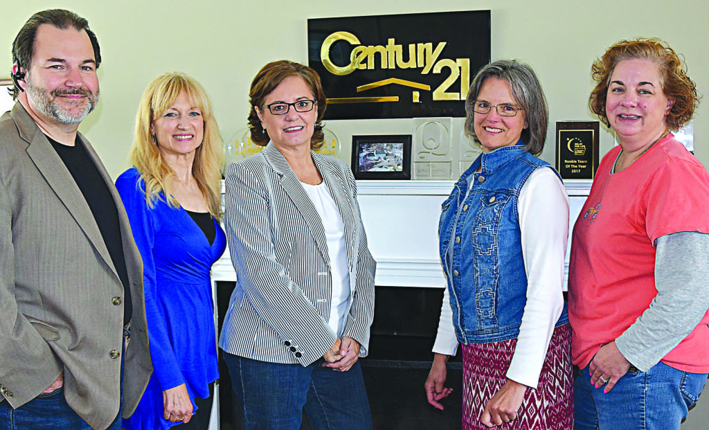 Managing Broker Jack Tubbs (far left) and Century 21 Affiliated staff pose at the Oxford office, located at 850 S. Lapeer Rd., where supplies will be collected to benefit victims of Hurricane Harvey. Photo by Elise Shire.