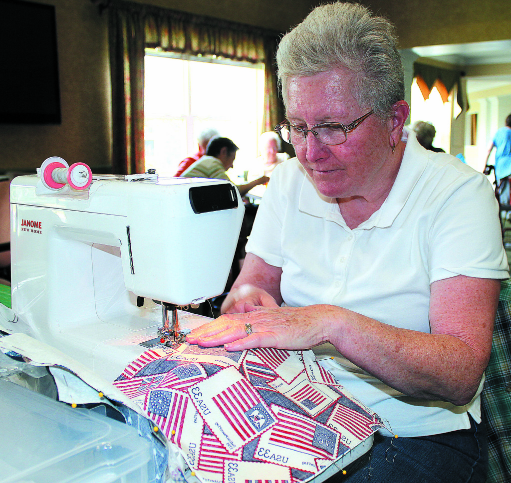 Dryden Township resident Karen Angell works away on her sewing machine. Photo by C.J. Carnacchio.