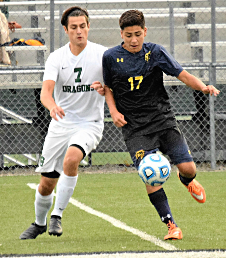 Oxford's Chris Escalante (right) and Lake Orion's Justin Fraser battle for the ball.