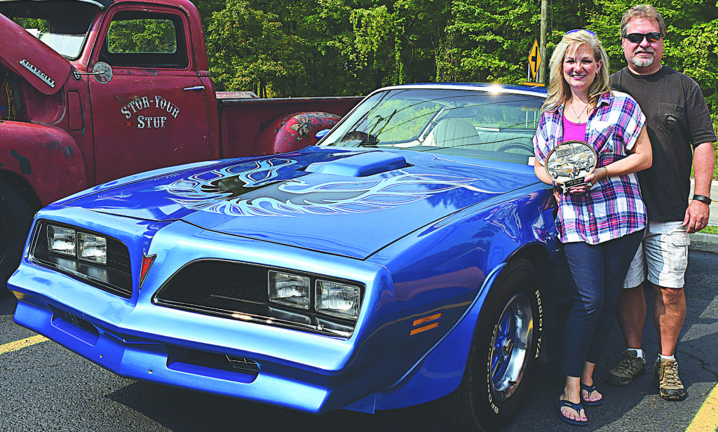 Leonard resident Stephanie Persico (left) won first place in the classic car category with her 1978 Trans Am. With Stephanie is her husband Dwayne Persico. Photo by Elise Shire.