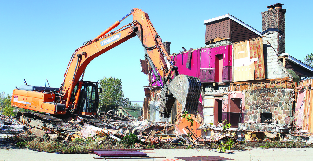 It didn't take very long to reduce the former Burning Oak Smokehouse building to a heap of rubble. Photos by C.J. Carnacchio.