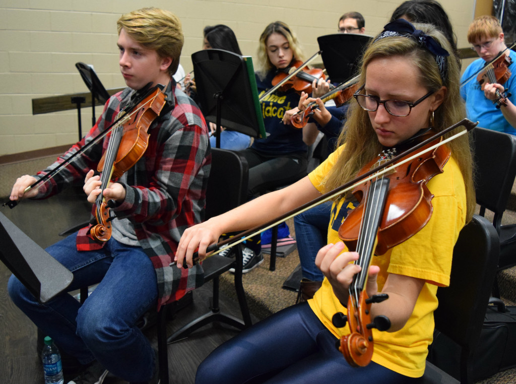 Oxford High orchestra students Ethan Pearson and Tabitha Sterner perform their parts on the violin. Photo by Elise Shire.