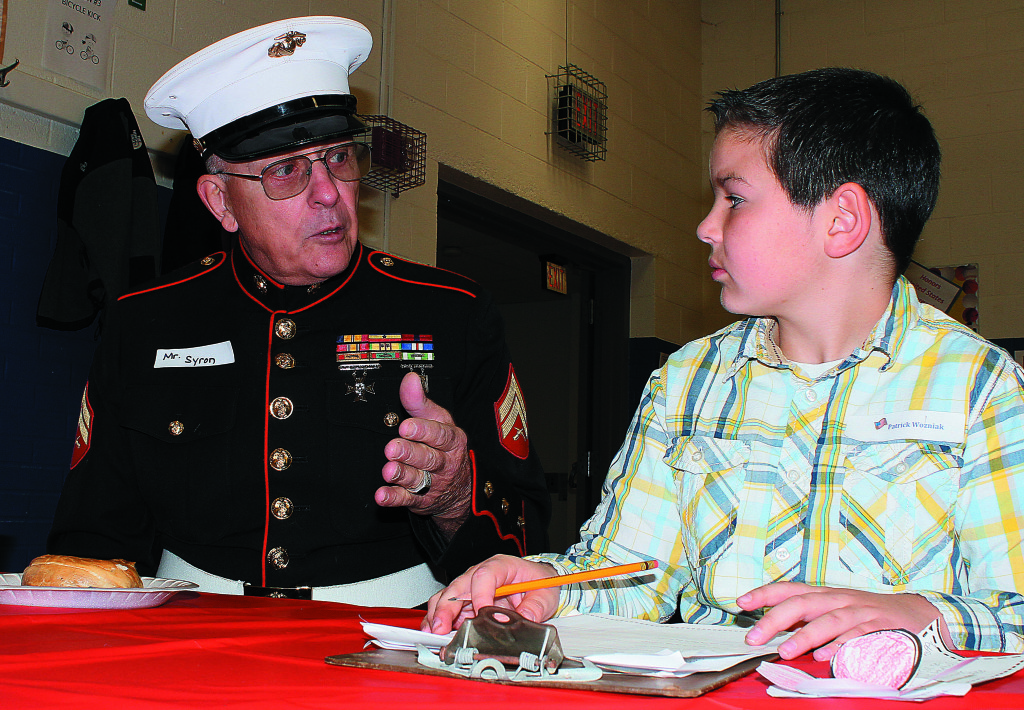 Oxford resident Hugh Syron wore his Marine Corps dress blues for his big interview with Leonard fifth-grader Patrick Wozniak. Syron served in the Corps from 1965-69 and spent 14 months in Vietnam. Photo by C.J. Carnacchio.