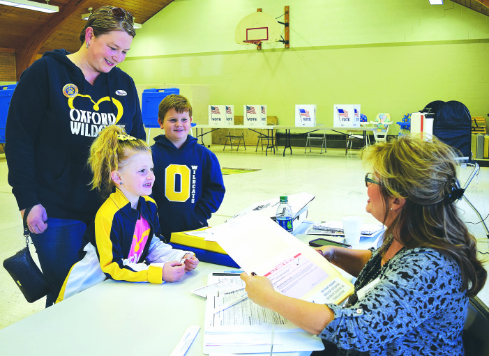 Voters OK bond, sinking fund for schools