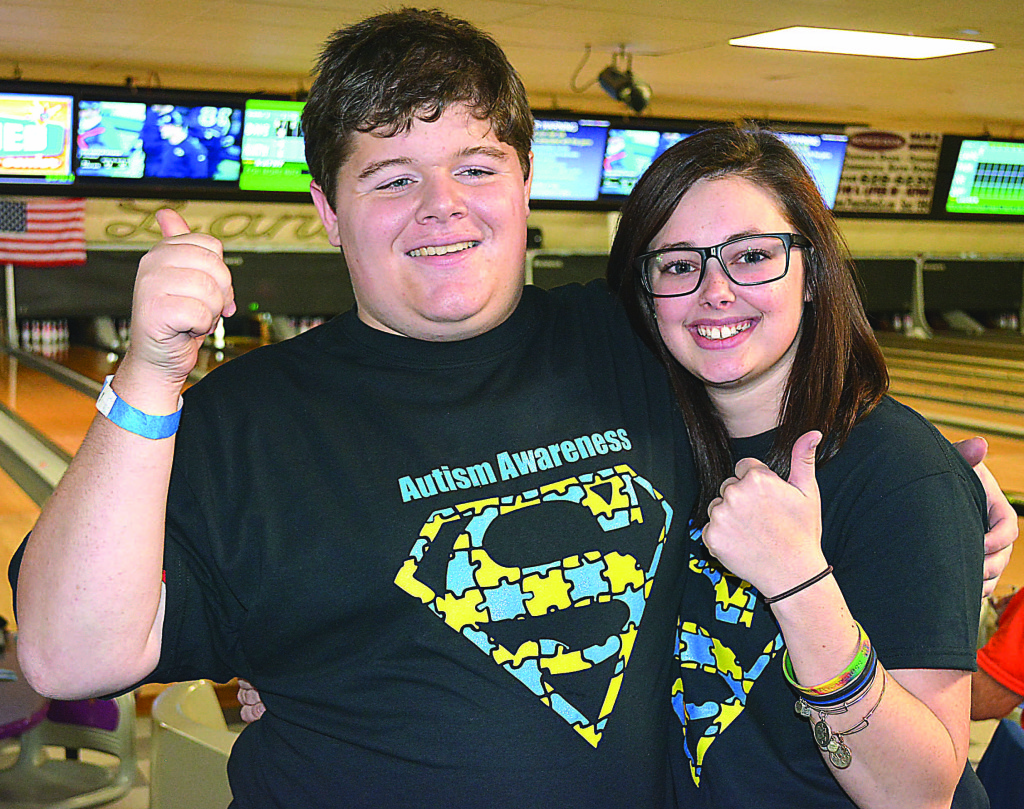 Andrew Pezolt (left) and Jordyn Zyngier gave a big thumbs up to the approximately 100 folks who attended the Autism Awareness fund-raiser held Sunday at Collier Lanes. Photo by CJC.