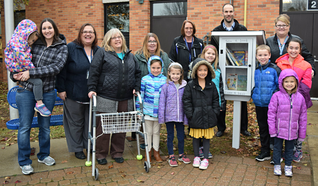 Students and staff from the OELC Extended Day and Great Start Readiness Programs (GSRP) filled Clear Lake's new Little Free Library with books last Wednesday. Those who helped were Pat Mueller, Maggie Hosner, Macy O'Neill, Avery Adams, Dianna Wright, Aiden Minke, Alivia Eagle, Audrey Corbett, Ariana Naegle, Geena Naegle, Karen Morris, Kim Keenan, Dee Thiele, Principal Brad Bigelow and Laura Armbruster. Photo by Elise Shire.
