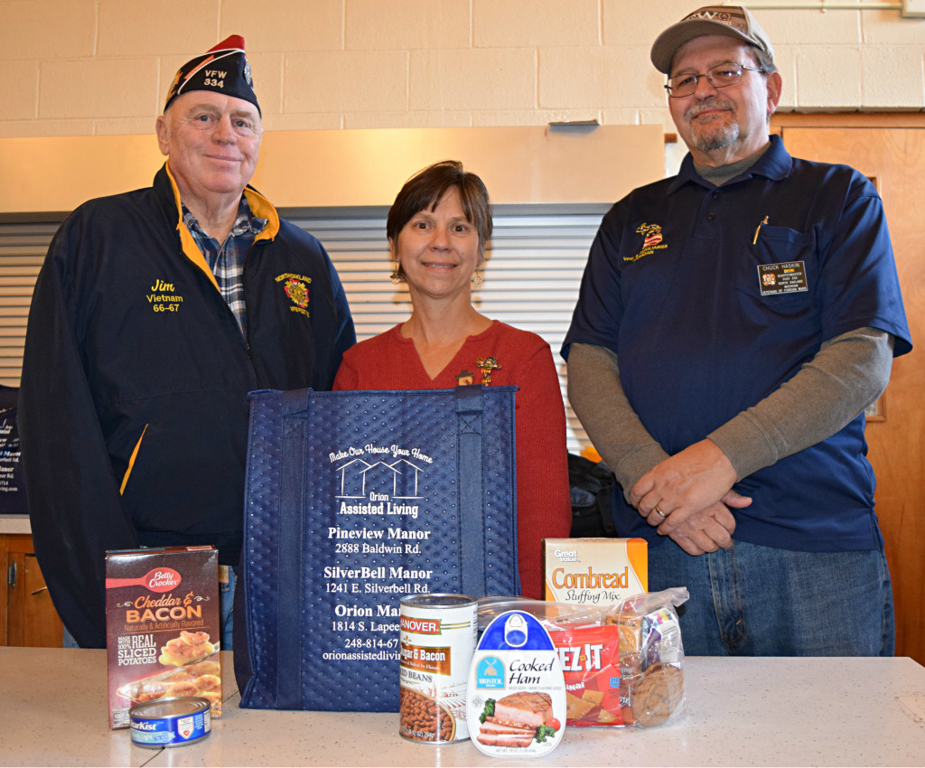 The North Oakland Veterans of Foreign Wars (VFW) Post 334 Commander Jim Hubbard (left) and VFW Post 334 Quartermaster Chuck Haskin delivered 28 bags filled to the brim with food for local seniors. Meals on Wheels volunteer Mary Reynolds (center) helped distribute them. Photo by Elise Shire.