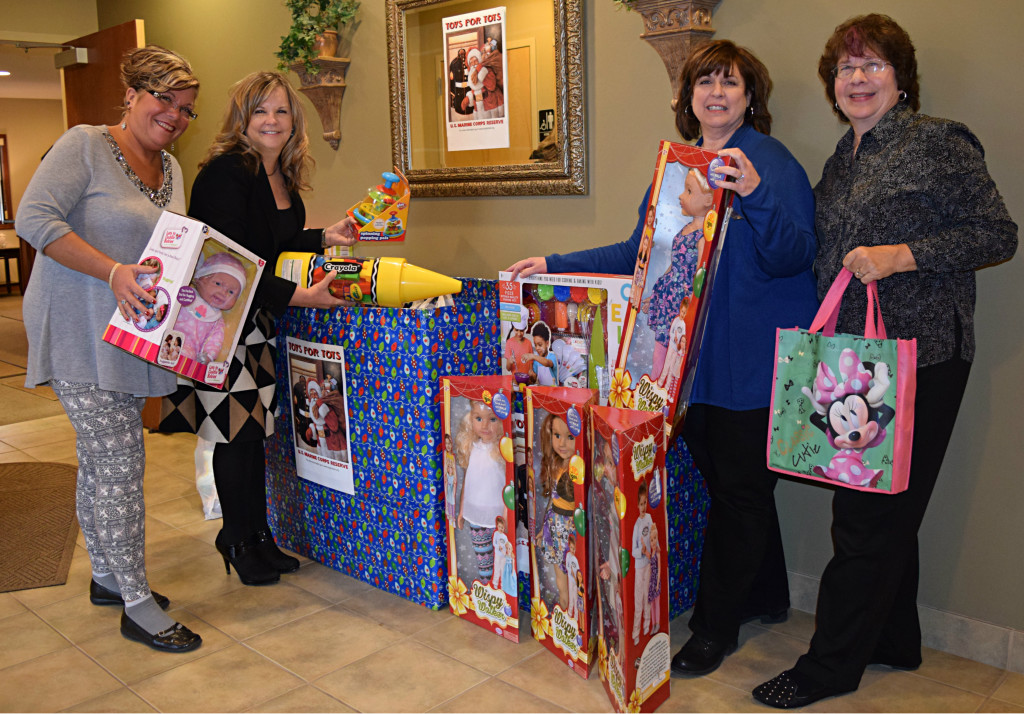 Real Estate One, located in Oxford, is accepting donations for Toys for Tots. Pictured are Cindy Arksey (left), Branch Mgr. Mary Matthews, Lisa Bunker and Judy Narducci. Photo by Elise Shire.