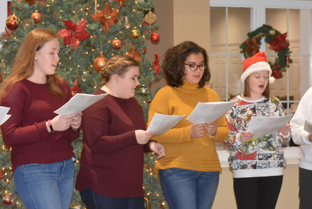 Oxford High School Spanish Club members (from left) Kaylie Seeling, Kylie Vittetoe, Olivia Rapadas and Abigail Smiles sing festive Christmas songs. Photo by C.J. Carnacchio.