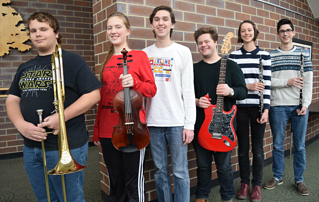 Tyler Dulinski (left) Nadia Smith, Zachariah Smith, Luke Sittard and Hayden Franke  perform with some of the state's top student musicians in Grand Rapids on Jan. 27. Selina Langfeldt (second to right) received an honorable mention. Photo by Elise Shire.
