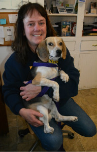 Lori Stevenson, president of the K9 Stray Rescue League, and L.B., a beagle for which the group is helping to get a prosthetic leg. Photo by C.J. Carnacchio.