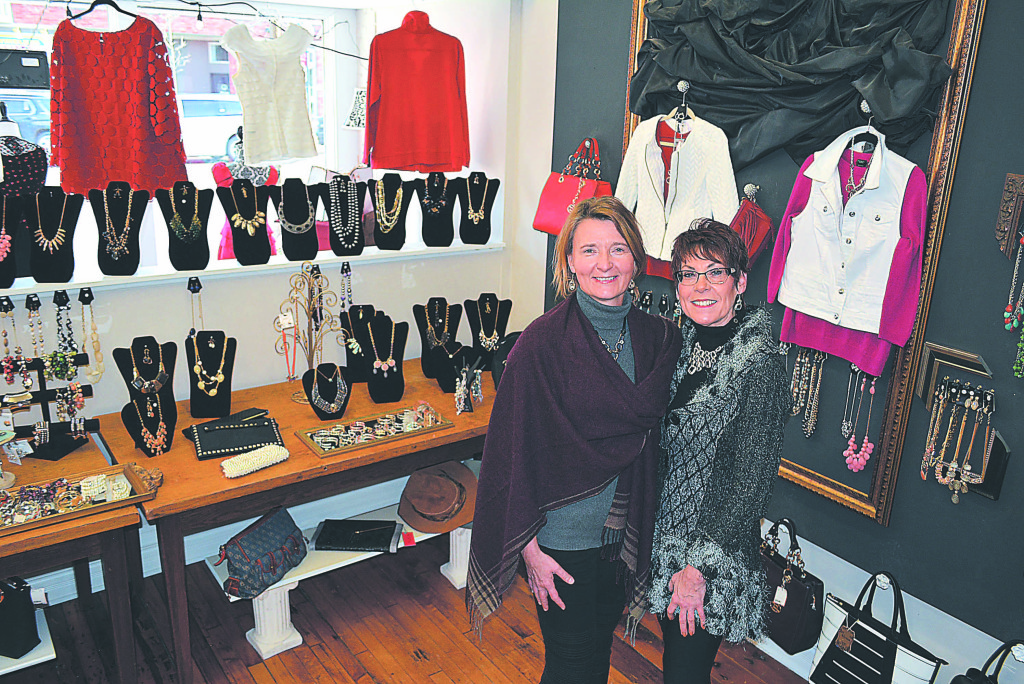 Patricia Duke (left), director of Love INC of North Oakland County, and Boulevard Boutique owner Sue Oles are hoping to sell 200 tickets to the Feb. 28 fashion show fund-raiser. Tickets are available at the 5 S. Washington St. store. Photo by C.J. Carnacchio.