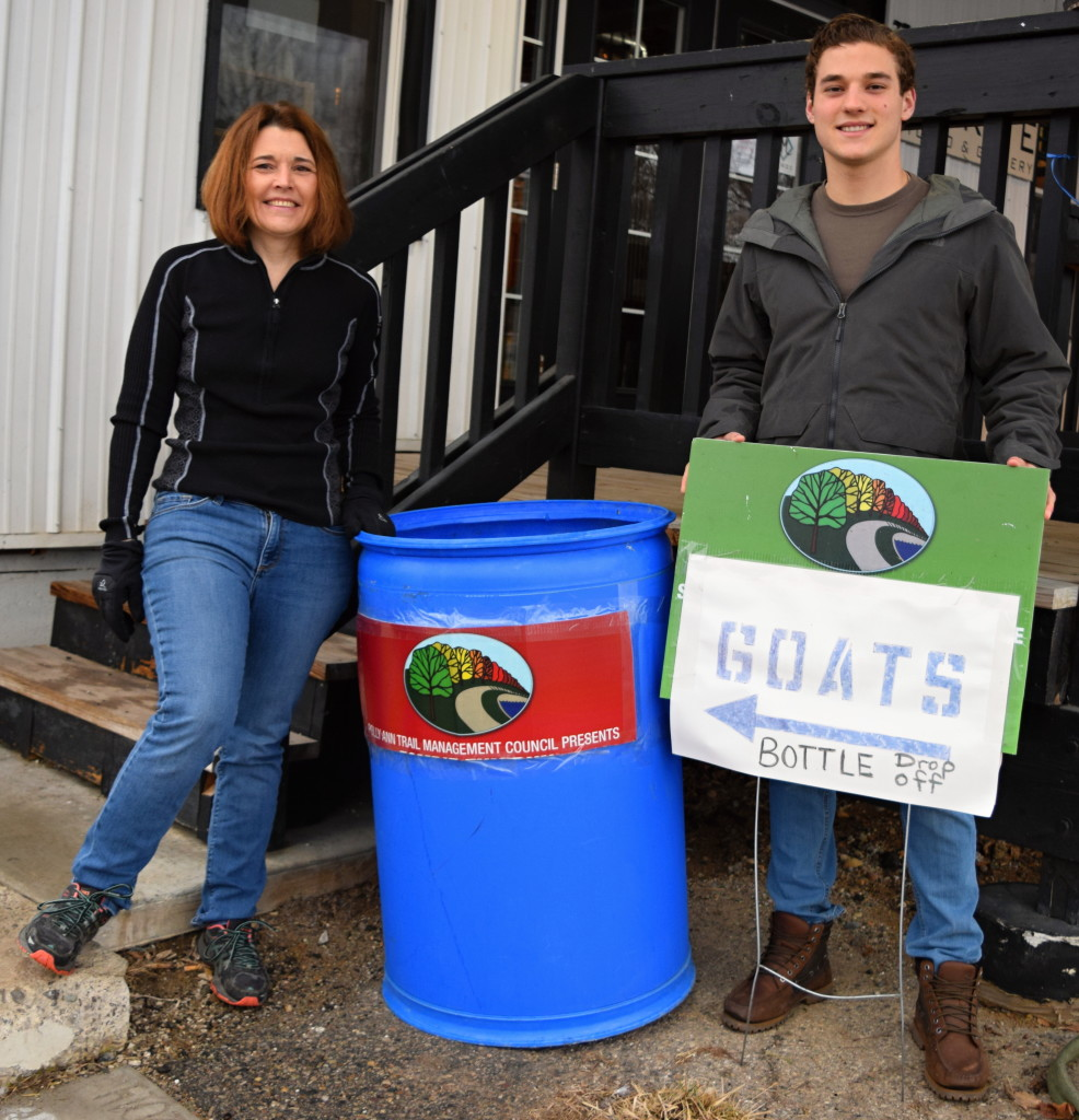 Polly Ann Trail Manager Linda Moran (left) and Sam Urban, a fifth-year Oxford Schools Early College student, are asking folks to donate their returnable bottles and cans to help pay for goats that munch on invasive plants. Photo by Elise Shire.