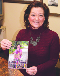 "Terra Kern, a 1980 OHS graduate, and her new book ""Here Comes Little Jenna Jafferty."" Photo by CJC."