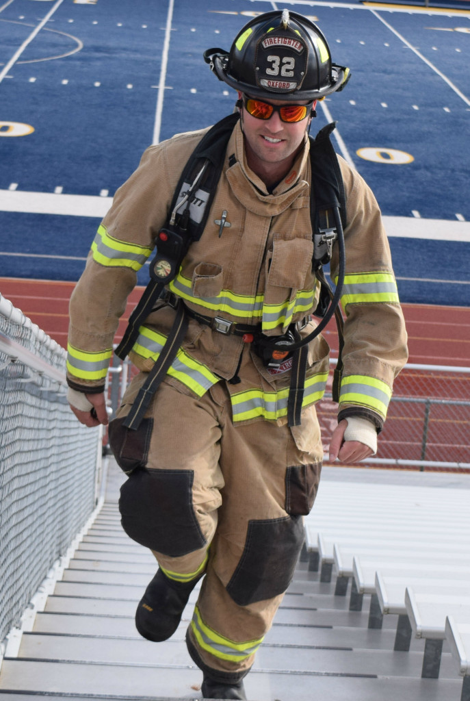 Oxford firefighter Ryan McLeod was one of eight emergency personnel who ran the steps of the OHS stadium bleachers on Sunday. He led the team that day, running 1,050 steps in a time of 22 minutes and 35 seconds. Photo by Elise Shire.