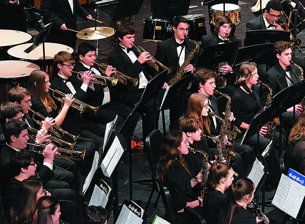 Oxford High School's Symphonic Band, conducted by Jim Gibbons, performs during the Michigan School Band and Orchestra Association's District 3 Festival held Friday and Saturday at the OHS Performing Arts Center. The band received straight 1's (the highest score possible) from the judges. Photo by C.J. Carnacchio.
