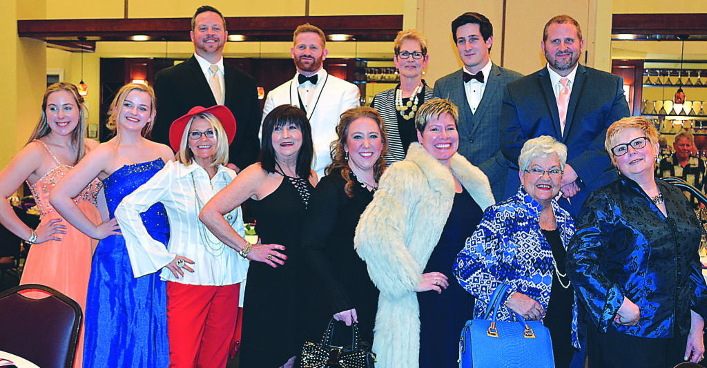 Models at the Love INC fashion show fund-raiser held Feb. 28 at the Boulder Pointe Golf Club and Banquet Center in Oxford included: Back row (from left) – Chris Barnett, Jordan Quick, Lori Greco, Anthony Grupido and Matt Pfeiffer. Front row (from left): Margaret Vieaux, Julie Gressier, Carolyn Vandenkieboom, Louise Clouse, Jessica Christensen, Jill Brzezinski, Nancy Keel and Leslie Wesclay.