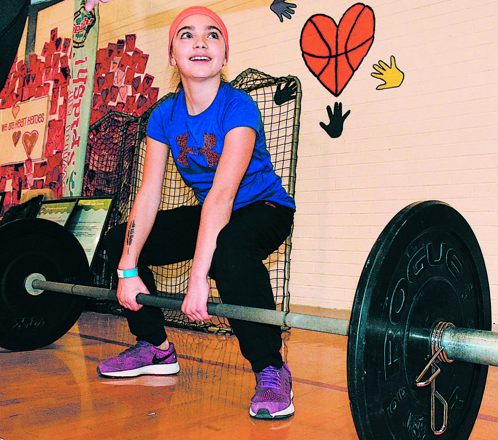 Lakeville fifth-grader Anna Terenzi is ready to pump some iron. Photo by C.J Carnacchio.