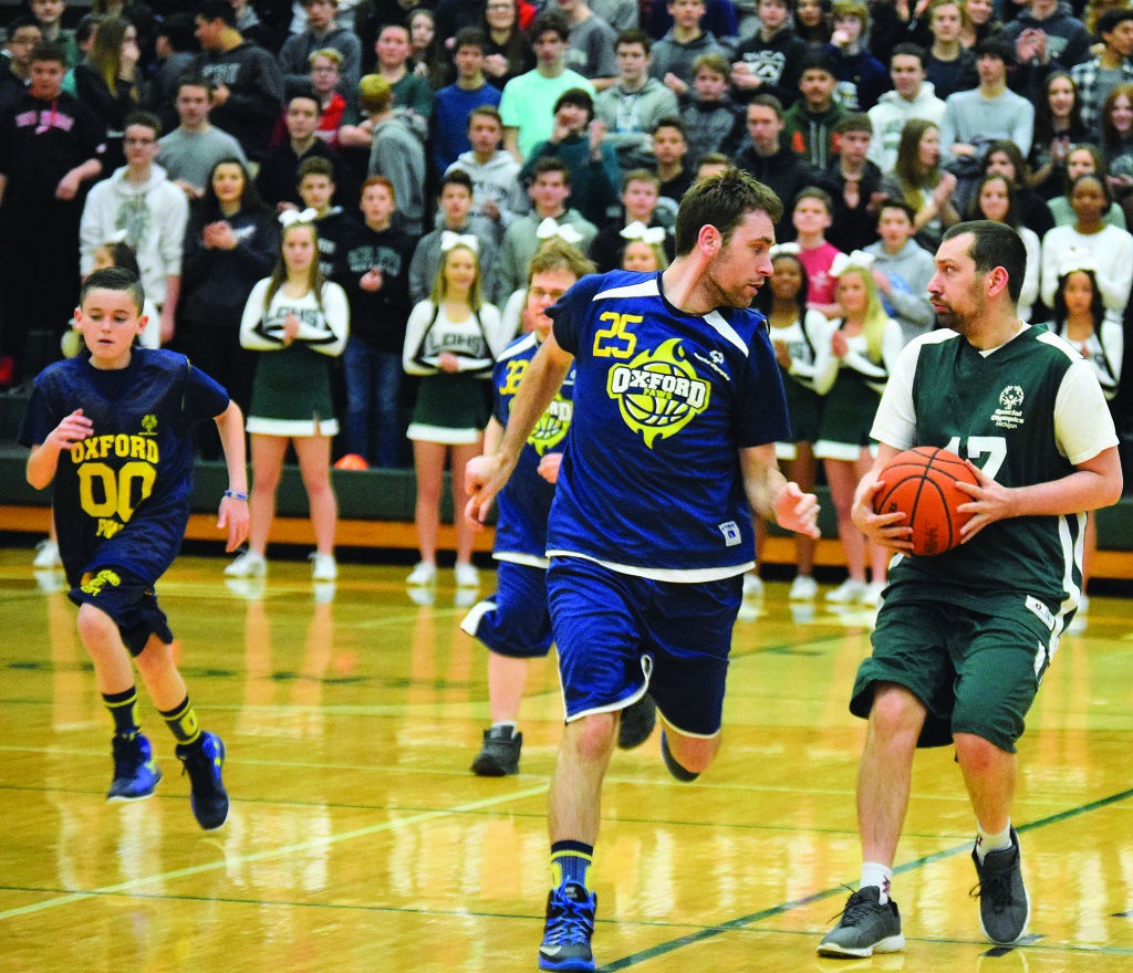 Oxford's Gregg Bett. no. 25, chases down Bryan Betty, of Lake Orion.