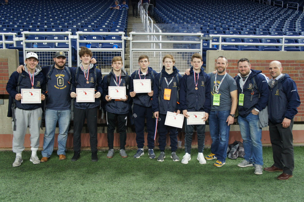 Wildcat grapplers who competed at the MHSAA Individual State Finals last Saturday included Trent Myre (from left), Ryan Miller, Sergio Borg, Liam Hillary, Ashton Anderson and Matthew Curtis. Joining them are Coach Ross Wingert, Coach Brandon Rank, Coach Alan Wilfong and Coach Craig Trombly. Photo provided.