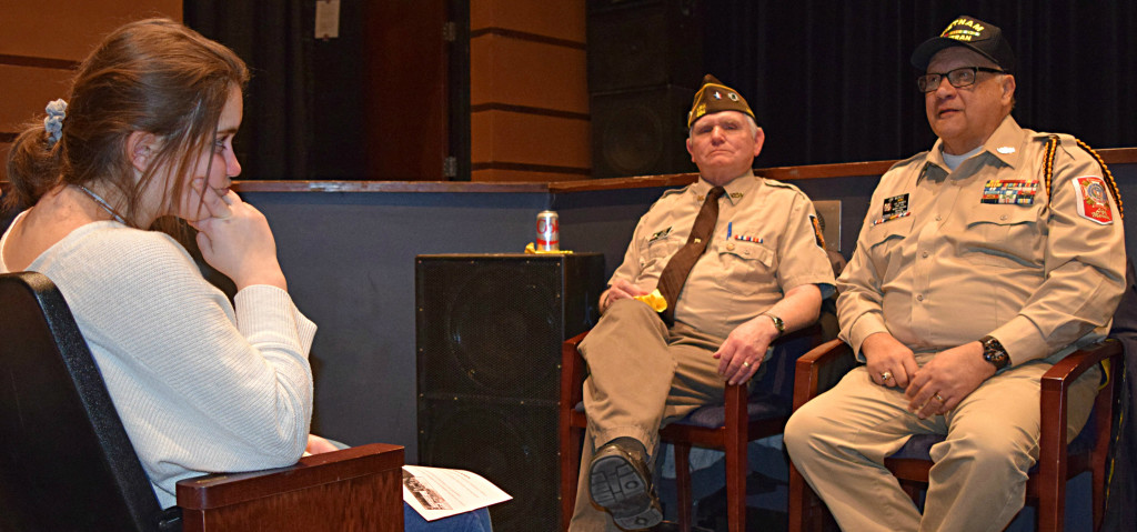 Greg Jones (left), an Air Force veteran and Jim Munoz, a Navy veteran, speak to Oxford High students. Listening is Syrena Coker. Photo by Elise Shire.