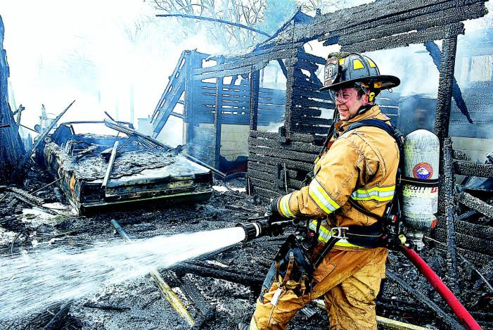Vintage vehicles, biz files burn in barn fire