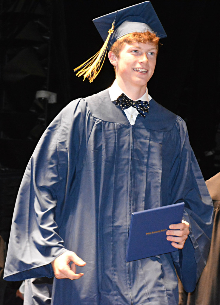 With diploma in hand and a smile on his face, Jacob Sharpe ends his high school career. Photo by C.J. Carnacchio.
