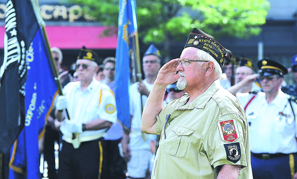 Oxford resident Jim Muys, a veteran of the U.S. Navy and Vietnam War, salutes during the Memorial Day observance in downtown Oxford's Centennial Park. Photo by CJC.